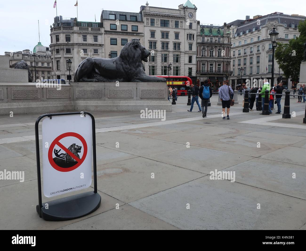 a-warning-sign-in-trafalgar-square-advis